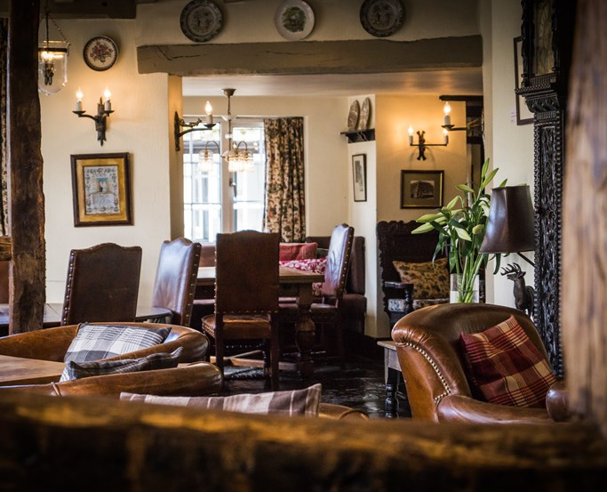 Comfortable leather seating in The Wild Boar's Lounge & Bar