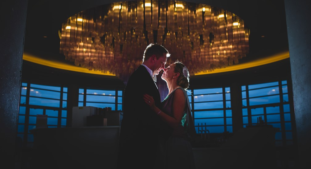 Couple in silhouette at The Midland's Rotunda Bar for wedding photography