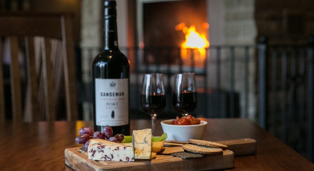 Bottle of Sandemans Port and a Cheese board in The Sandemans Bar at Lancaster House Hotel