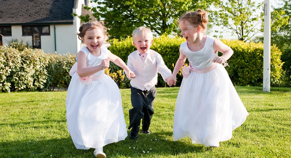 Children running on the lawns - Weddings at Lancaster House