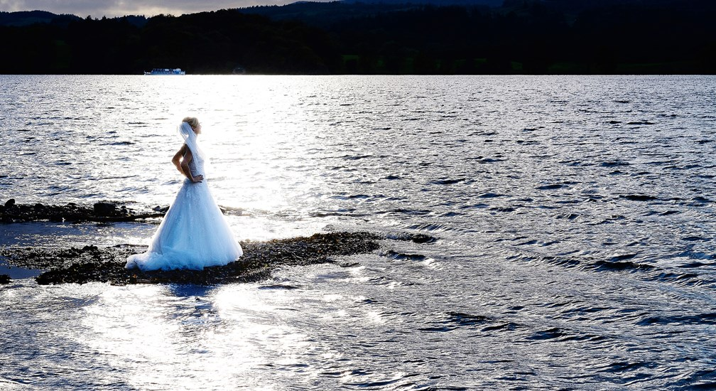A bride on the shores of Lake Windermere