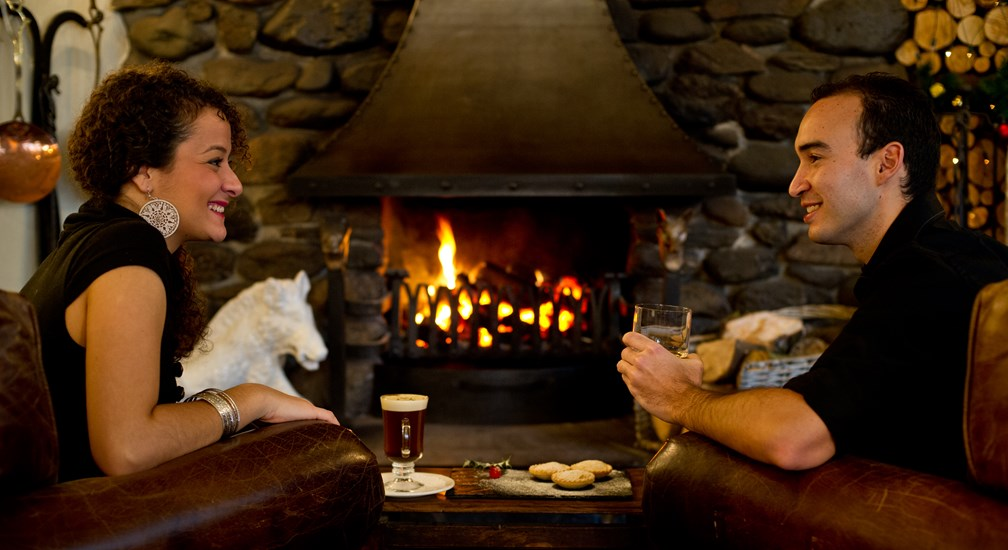 A couple celebrating Christmas at The Wild Boar, Windermere