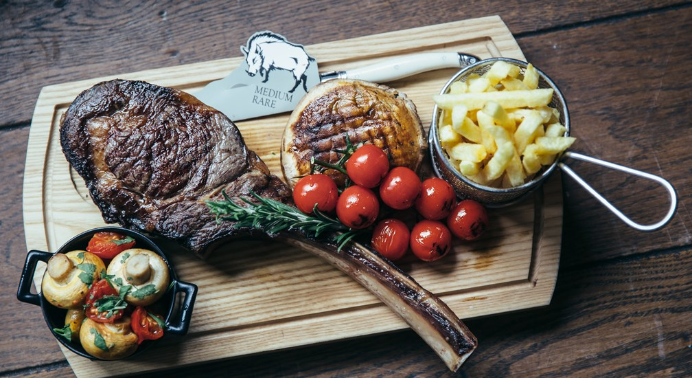 Tomahawk Steak, menu selection from The Grill & Smokehouse Restaurant at The Wild Boar