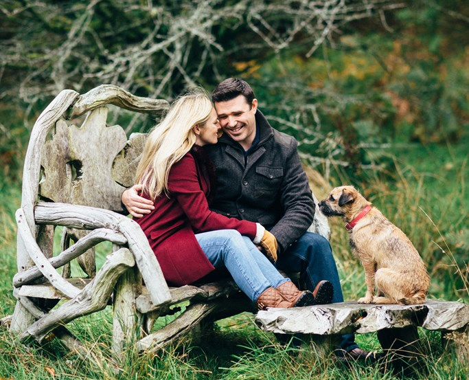 A couple with their dogs at The Wild Boar private woodlands