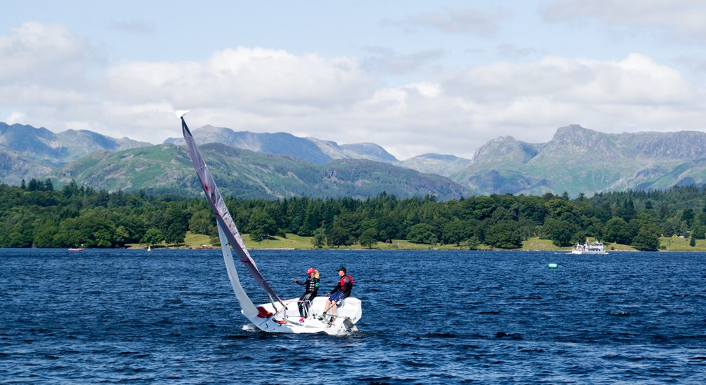 Two people sailing on Lake Windermere