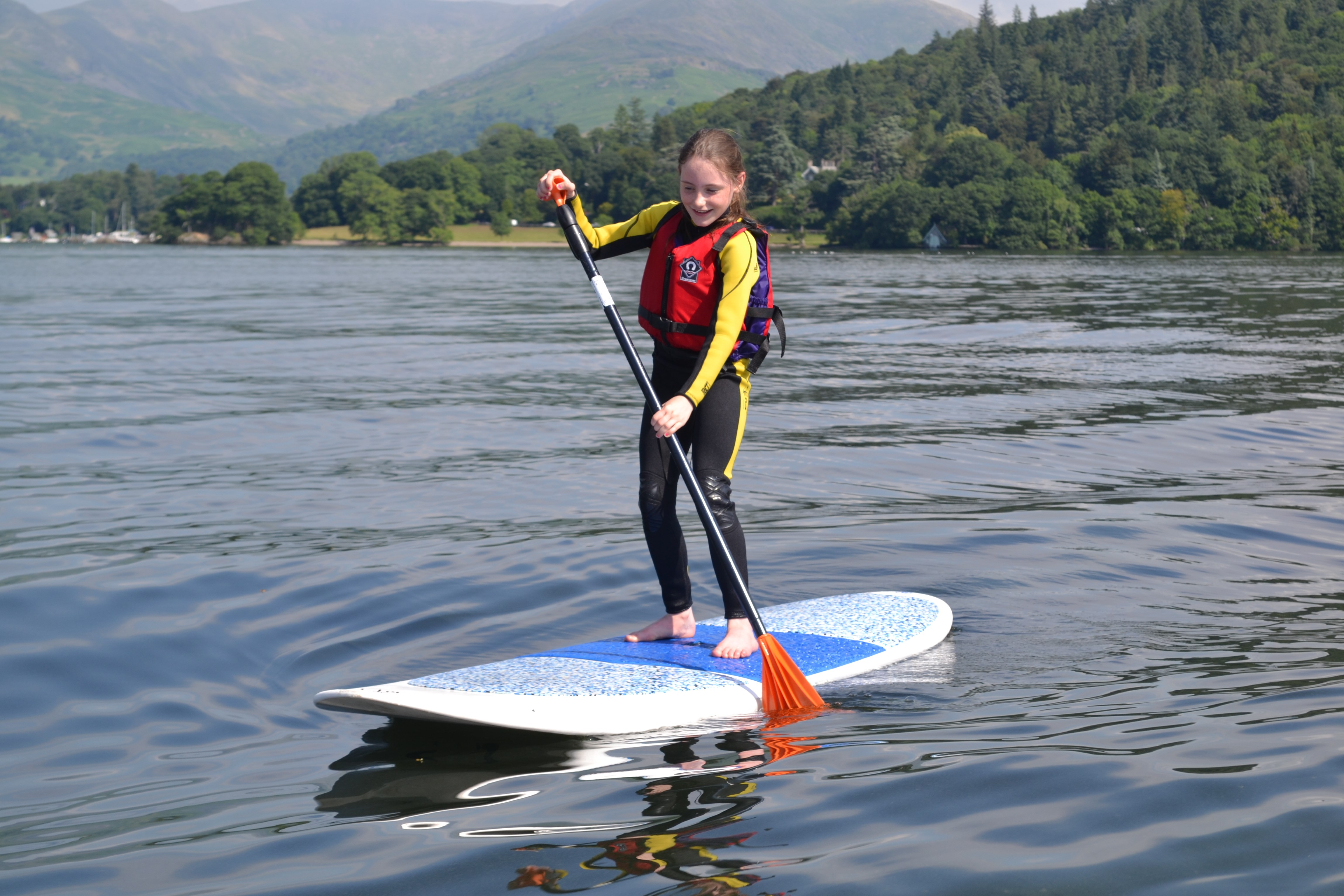 Learning to paddle board on Lake Windermere