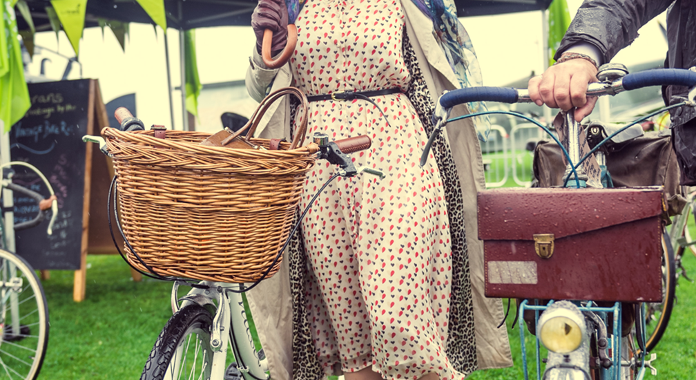 A lady with a vintage bike at The Midland, Morecambe