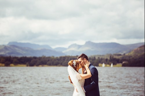 Bride & Groom kissing on the Jetty at Low Wood Bay