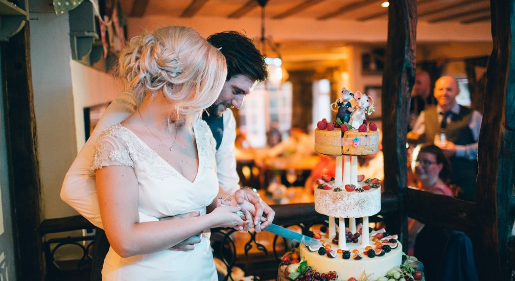 Bride and Groom cutting the wedding cake at The Wild Boar