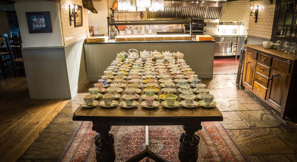 Myriad teacups on the Chefs Table ready for the wedding guests at The Wild Boar