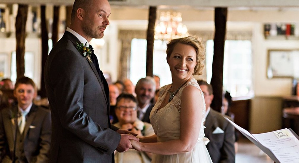 The Bride and Groom taking their wedding vows at The Wild Boar