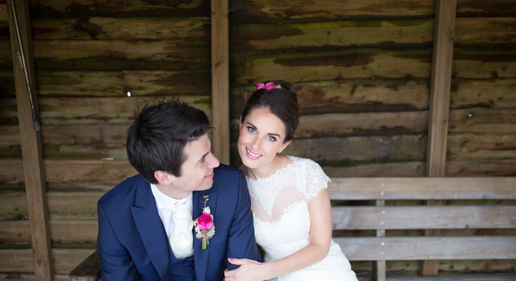 Bride and Groom sat in the shed post wedding at The Wild Boar