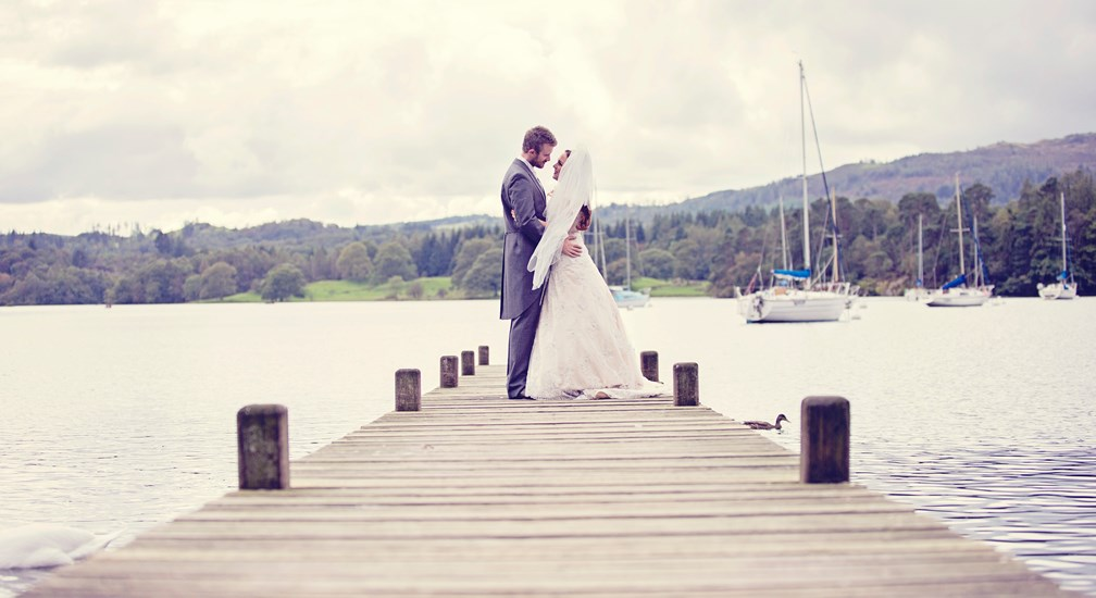 Couple posed for the wedding photographer on the Waterhead lake jetty