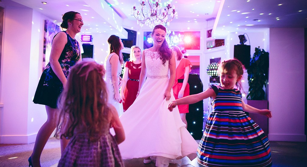 Dancing Bride and wedding guests at The Waterhead