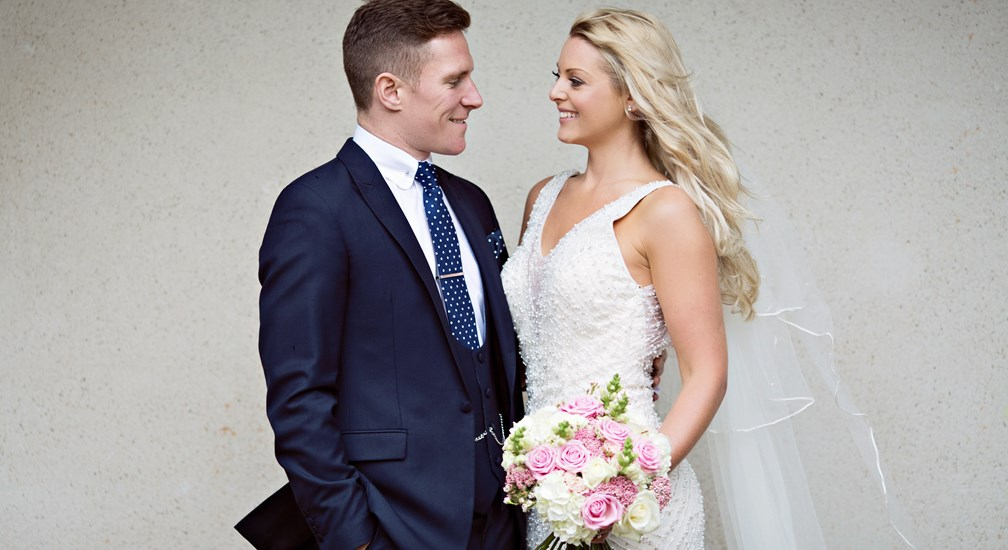 Bride & Groom  posed for the Wedding Photographer at Lancaster House Hotel