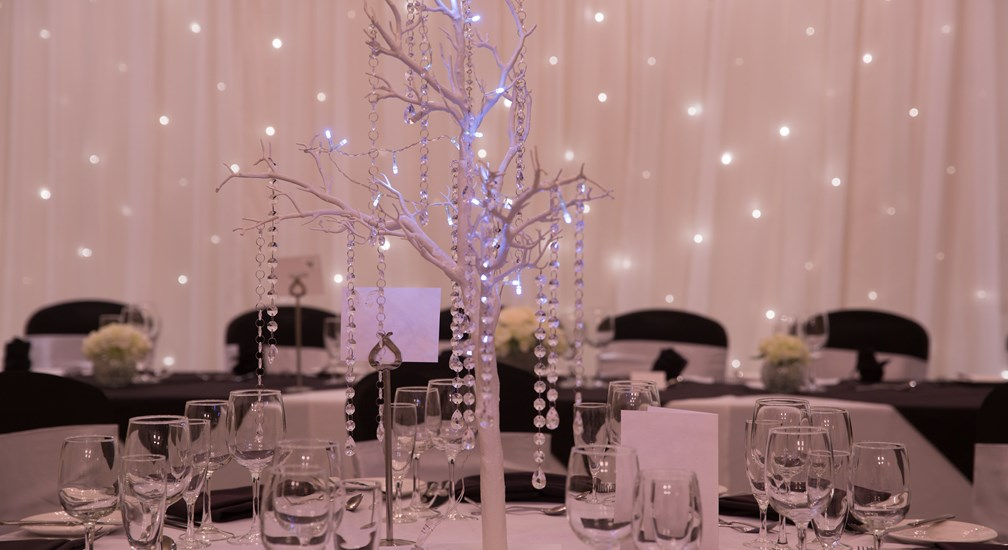Wedding Breakfast Table arrangements with fairy lights at Lancaster House Hotel