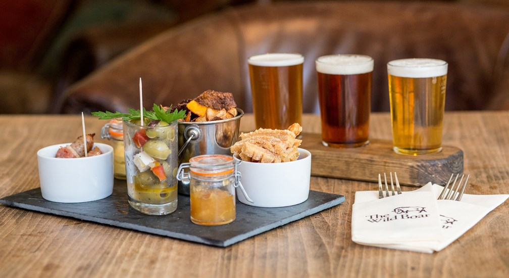 Bar snacks and beers at The Wild Boar, near Windermere