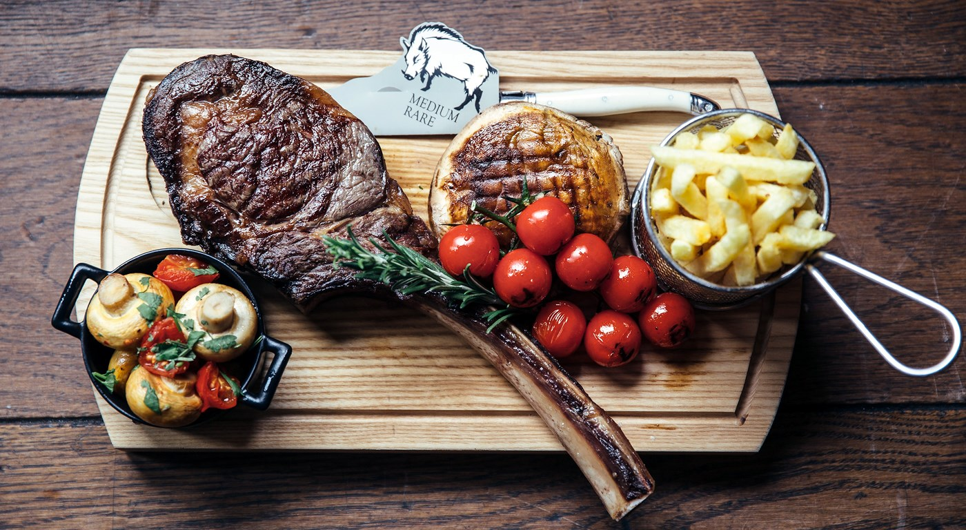 Tomahawk Steak with Chips and dressing - The Wild Boar Menu Sample