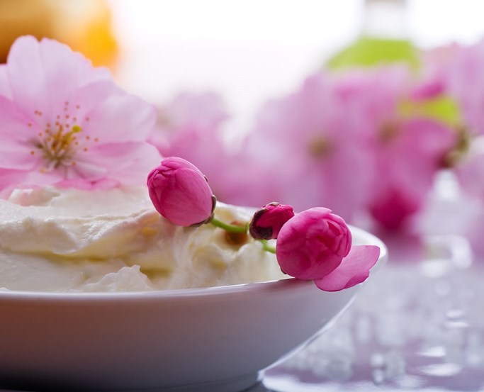 Cream preparation with pink flowers