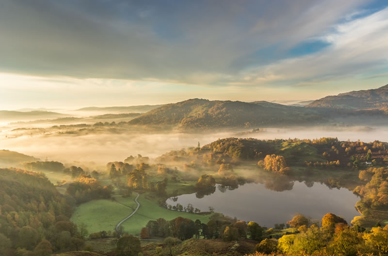 Morning mist over Loughrigg Tarn
