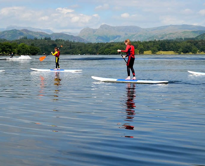 Family paddleboarding with The Watersports Centre at Low Wood Bay Resort & Spa